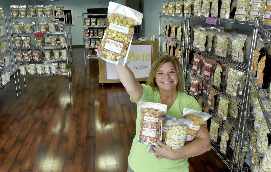 Stephanie Dudding, owner of Inpopnito, in the new shop that sells gourmet flavored popcorn at 3 River St. in Milford. Photo: Peter Hvizdak / Hearst Connecticut Media / New Haven Register