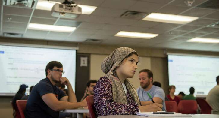 Saeideh Ahmadi listens to Adolfo Matamoros, director of the UTSA civil engineering doctoral program, lecture about Òreinforced concrete designÓ on how to build longevity into building structures on Friday, August 31st, 2018. The doctoral program opened this semester to respond to demand for more civil engineering which, experts say, was learned after Hurricane Harvey. The civil engineering PhD program has twenty students, more than triple their expectations. UTSA Population growth in Texas plus Hurricane Harvey have shown a need for more civil engineers, especially along the coast because coastal engineering is so specific and complex, engineering experts say.  Previously, students wanting this specific PhD would've gone to Austin or Houston.