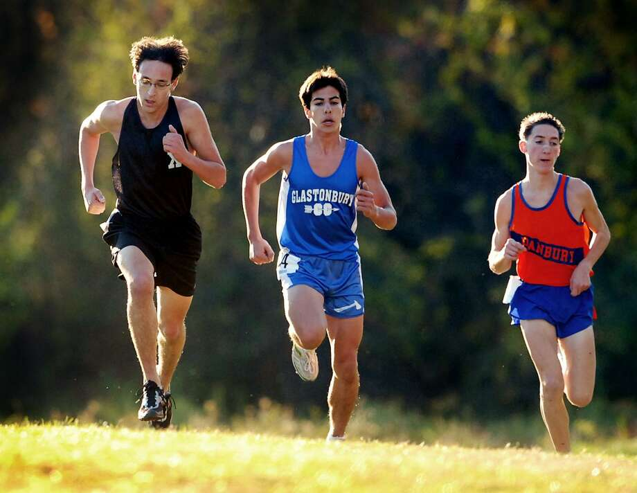 Donn Cabral, center, was a junior at Glastonbury High while competing in the 2006 Class LL cross country championship in East Hartford. Cabral won the event. Photo: Hearst Connecticut Media File Photo