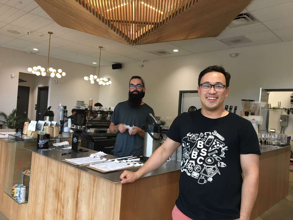 Fussy Coffee co-owner David Negreiro is at right.