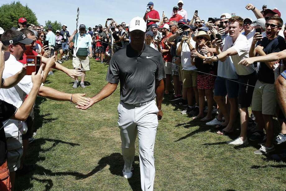 Fans cheer as Tiger Woods walks off the third green during the third round of the Dell Technologies Championship Sunday in Norton, Mass. Photo: Michael Dwyer / Associated Press / Copyright 2018 The Associated Press. All rights reserved