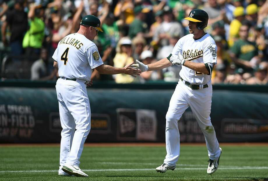 OAKLAND, CA - SEPTEMBER 02:  Stephen Piscotty #25 of the Oakland Athletics is congratulated by third base coach Matt Williams #4 after Piscotty hit a solo home run against the Seattle Mariners in the bottom of the fifth inning at Oakland Alameda Coliseum on September 2, 2018 in Oakland, California.  (Photo by Thearon W. Henderson/Getty Images) Photo: Thearon W. Henderson / Getty Images