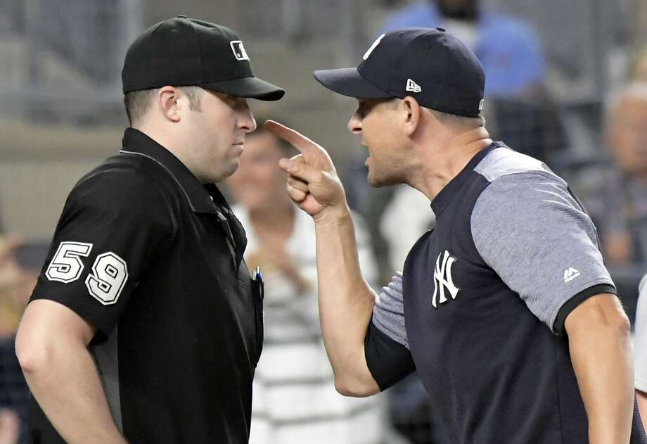 New York Yankees manager Aaron Boone (right) confronts umpire Nic Lentz before being ejected from a game against the Tigers on Friday night at Yankee Stadium. Photo: Bill Kostroun / Associated Press