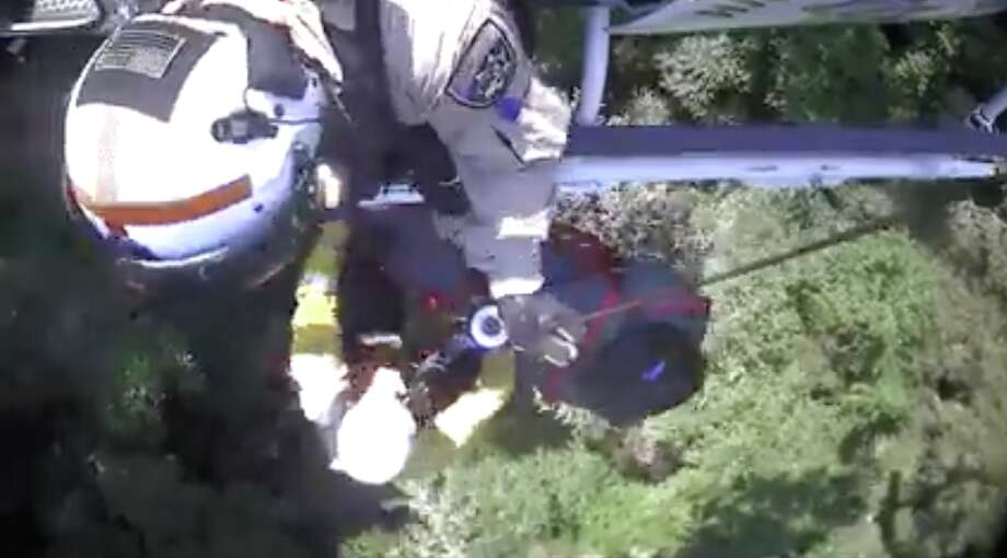 A woman injured while on a Mount Tamalpais hiking trail Sunday was lifted out of a ravine by a California Highway Patrol helicopter. Photo: Courtesy California Highway Patrol