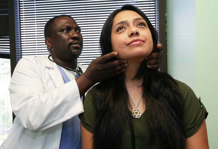 MBBS, MPAS, PA-C Wale Oshin performs check-up examine on patient Sandra Calderon at the East Harris County location of the United Health Partner (UHP) clinic on Friday, Aug. 31, 2018, in Houston. UHP has helped predominantly Blacks and Hispanics with Harvey relief. Calderon, 34, first learned about the clinic through the clinic's community outreach meeting and became a patient two weeks ago.
