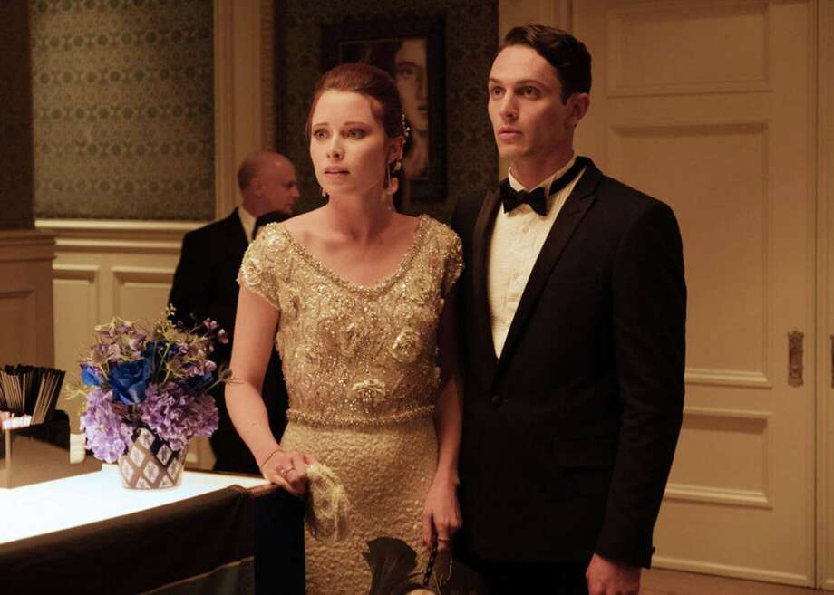 """An upwardly mobile couple (Hannah Emily Anderson, Colin Woodell) find they don't enjoy the entertainment at a swanky party on Purge night in the TV miniseries """"The Purge."""" The secret intent of the actual Purge, as revealed in the films, is the weaponizing of the non-rich against each other while the elite remain untouchable spectators. The show is full of bloody violence, but too predictable to shock. Photo: USA Network"""