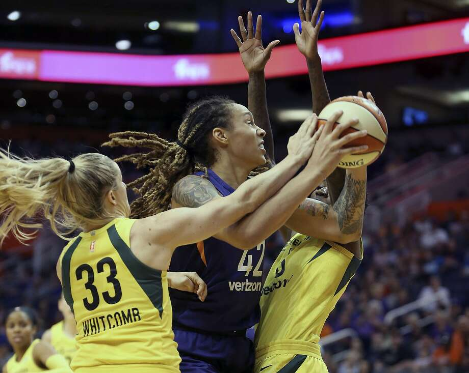 Phoenix Mercury center Brittney Griner (42) is guarded by Seattle Storm's Sami Whitcomb (33) and Natasha Howard as she tries to drive to the basket during the first half of Game 4 of a WNBA basketball semifinals playoff game, Sunday, Sept. 2, 2018, in Phoenix. (AP Photo/Ralph Freso) Photo: Ralph Freso, Associated Press