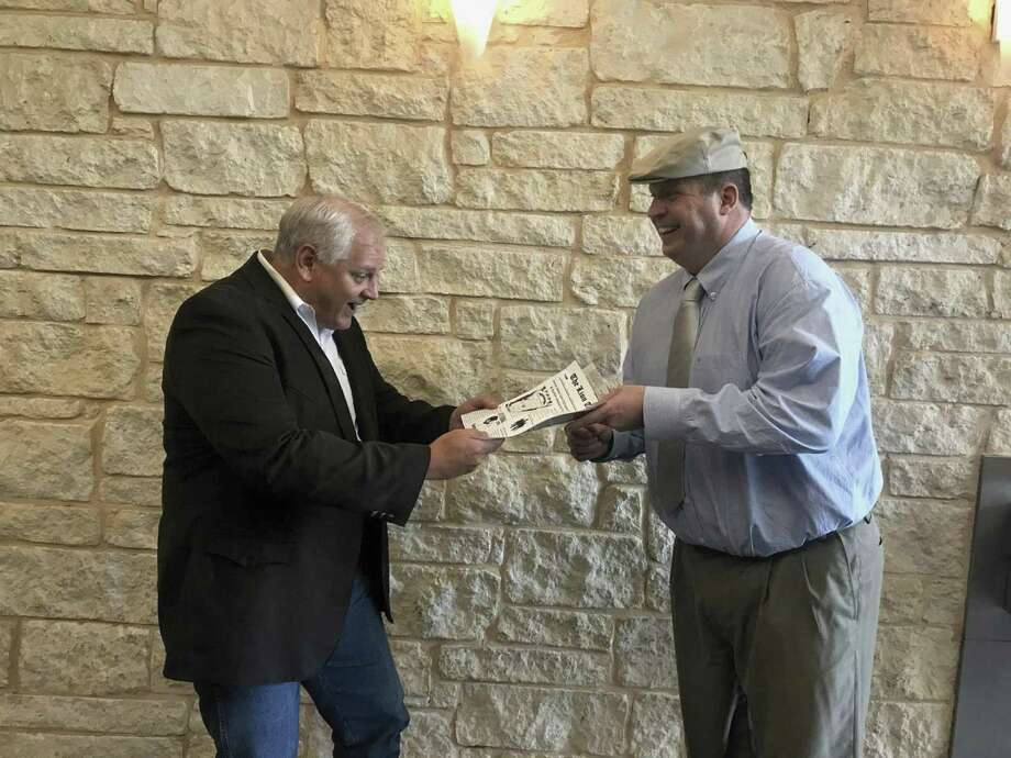 Conroe Noon Lions' infamous 'paperboy' Warner Phelps, right, delivered the news to VP Scott Perry, left, that the club's annual Dinner/Dance & Auction will be held on Thursday, Sept. 13 th  but the last day to purchase tickets is this Friday, Sept. 7 th.