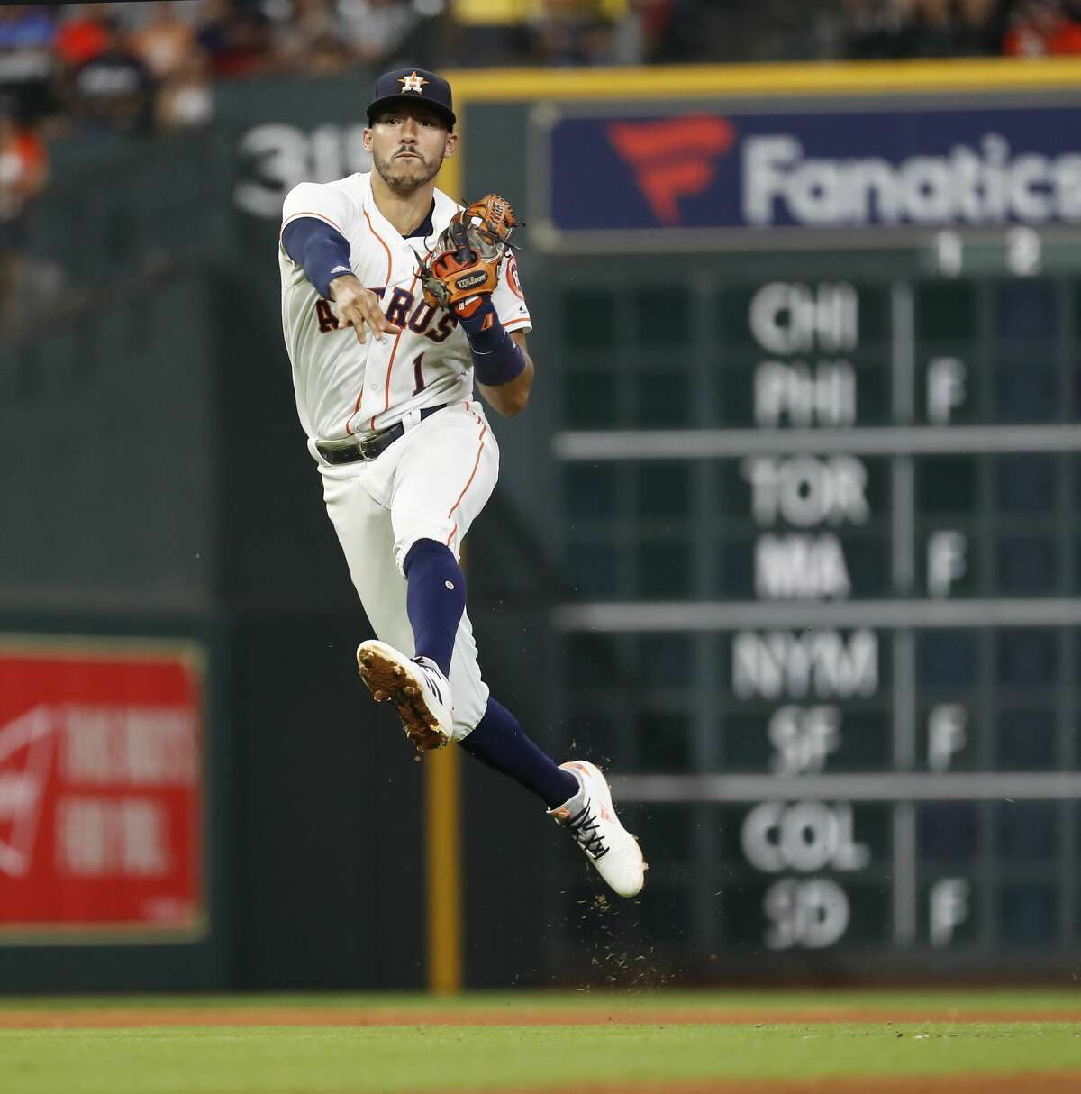 Houston Astros Carlos Correa (1) jumps up to make the throw to first as Los Angeles Angels David Fletcher (6) ground out during the fifth inning of an MLB baseball game at Minute Maid Park, Sunday, September 2, 2018, in Houston.