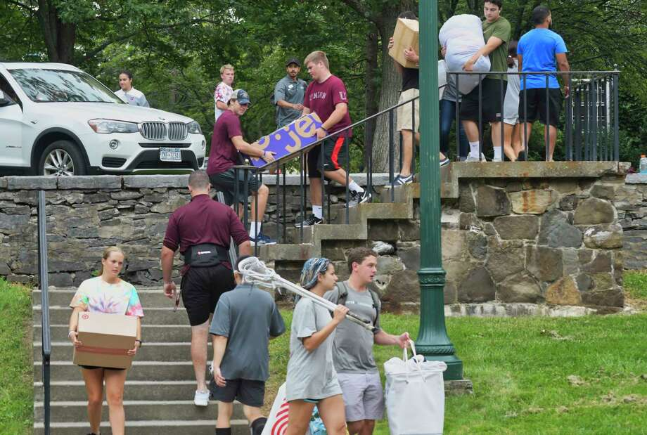 Athletes from various Union College sports teams help carry new student's belonging into their dorm during freshman move-in day at Union College on Sunday, Sept. 2, 2018, in Schenectady, N.Y.    (Paul Buckowski/Times Union) Photo: Paul Buckowski / (Paul Buckowski/Times Union)