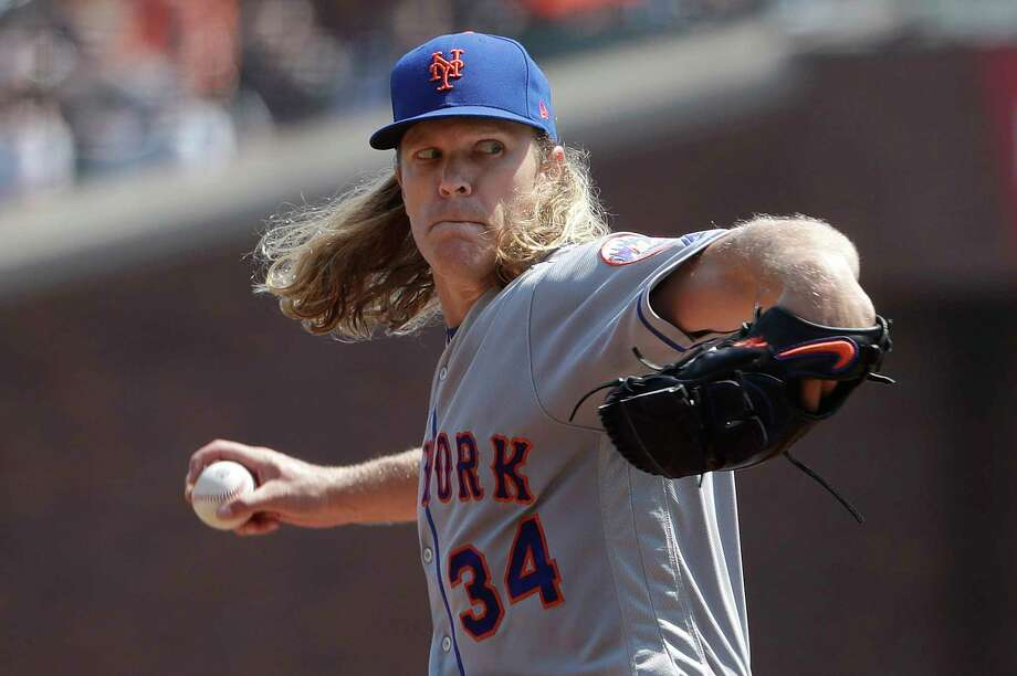 New York Mets pitcher Noah Syndergaard (34) throws against the San Francisco Giants during the second inning of a baseball game in San Francisco, Sunday, Sept. 2, 2018. (AP Photo/Jeff Chiu) Photo: Jeff Chiu / Copyright 2018 The Associated Press. All rights reserved