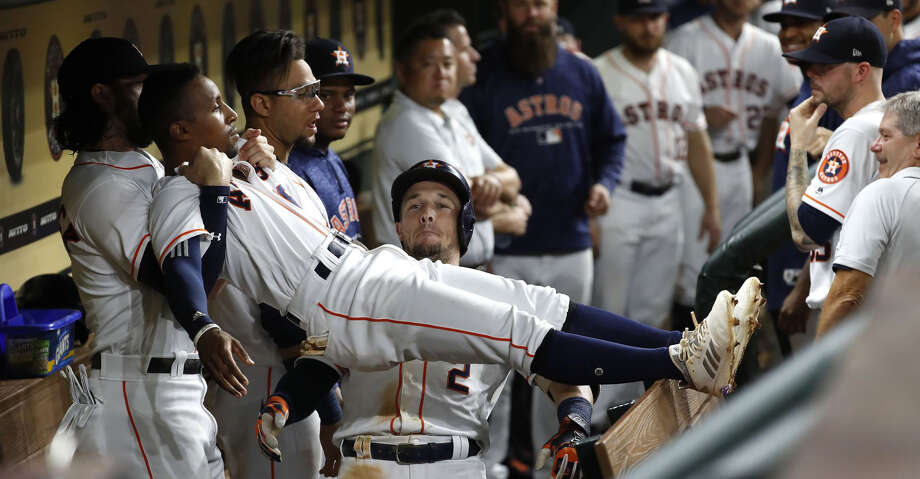 Houston Astros Alex Bregman (2) celebrates his home run with Tony Kemp and Jake Marisnick during the seventh inning of an MLB baseball game at Minute Maid Park, Sunday, September 2, 2018, in Houston. Photo: Karen Warren