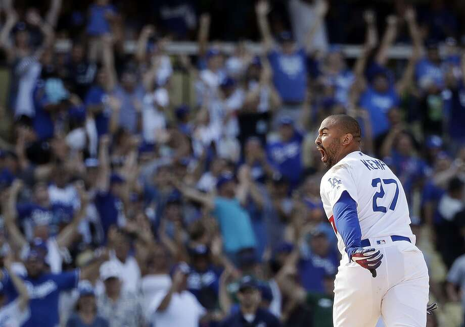 Matt Kemp celebrates after driving in two runs with a walk-off double in the ninth inning. Photo: Marcio Jose Sanchez / Associated Press