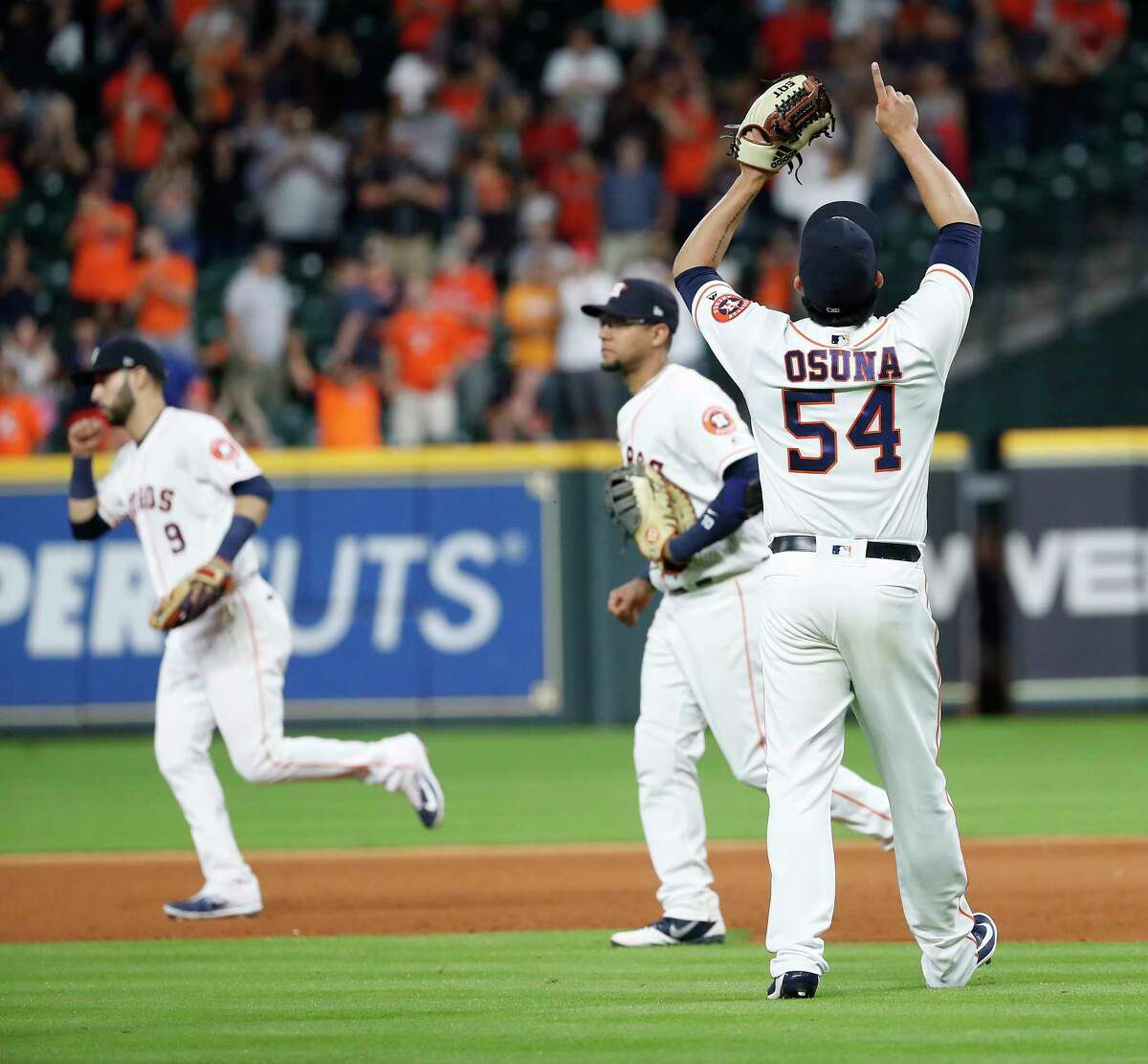 Houston Astros relief pitcher Roberto Osuna (54) celebrates the Astros 4-2 win over the Los Angeles Angels after the ninth inning of an MLB baseball game at Minute Maid Park, Sunday, September 2, 2018, in Houston.