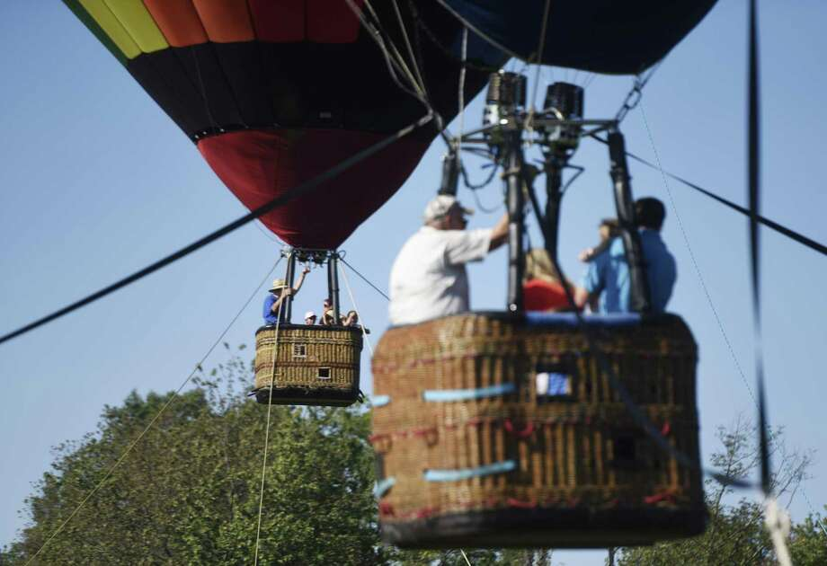 "Folks can ride in a hot air balloon at the Greenwich Land Trust's annual ""Go Wild"" event at the Greenwich Polo fields at Conyers Farm. The rides offer a spectacular view of the 62-acre preserve below. The event will be held from 3 to 6 p.m. Sept. 23. It also offers activities and entertainment for all ages, including live music, a rock-climbing wall, petting zoo, bungee trampolines, inflatable maze, animal encounters, gaga courts, autumn crafts, food, and much more. Adult tickets are $65 in advance ($75 at the gate); child tickets are $30; children under 3 are free. For more info and tickets, visit gltrust.org. Photo: File / Tyler Sizemore / Hearst Connecticut Media / Greenwich Time"