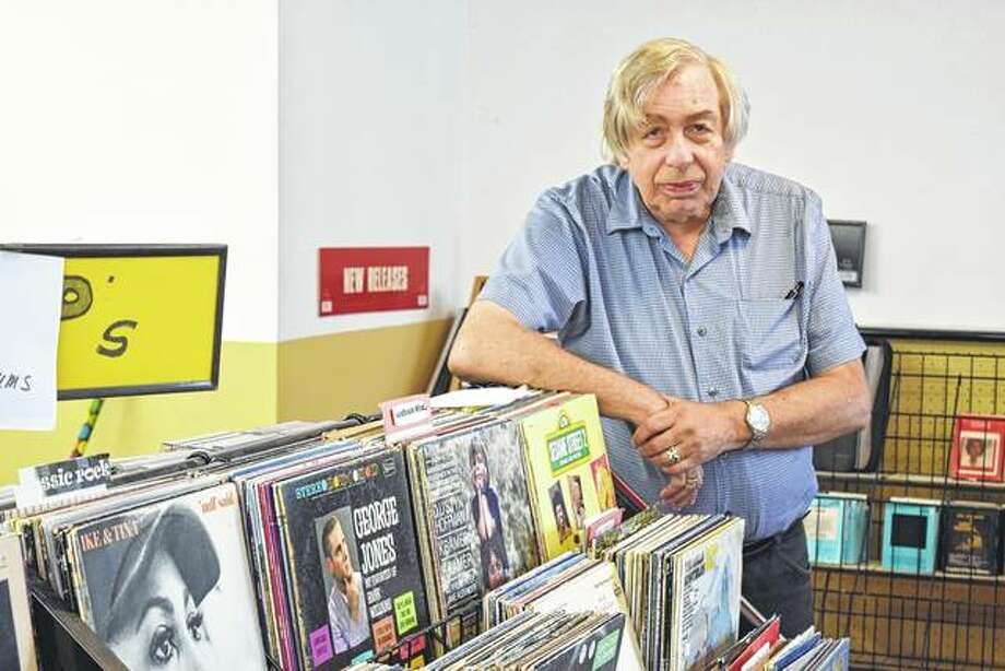 Stan Robinson stands in his West State Street record store, Revolution Records, which will close Friday. Photo: Greg Olson | Journal-Courier