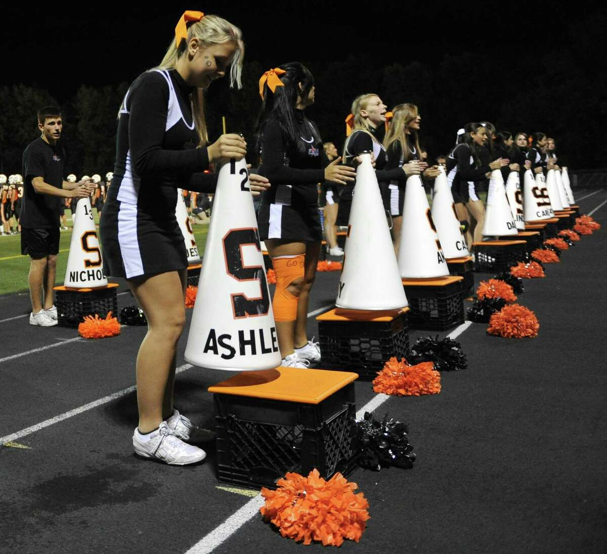 Shelton High School cheerleaders support the Gaels during Friday's game against Wilbur Cross High School on September 17, 2010.