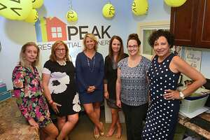 From left, Samantha Parker, Sandy LaValle, Leah Slocum, Jackie Hutchinson, Sherrie Young, Ann Manning stand in Leah Slocum's office at the Keller Williams office on Thursday, Aug. 9, 2018 in Latham, N.Y. (Lori Van Buren/Times Union)