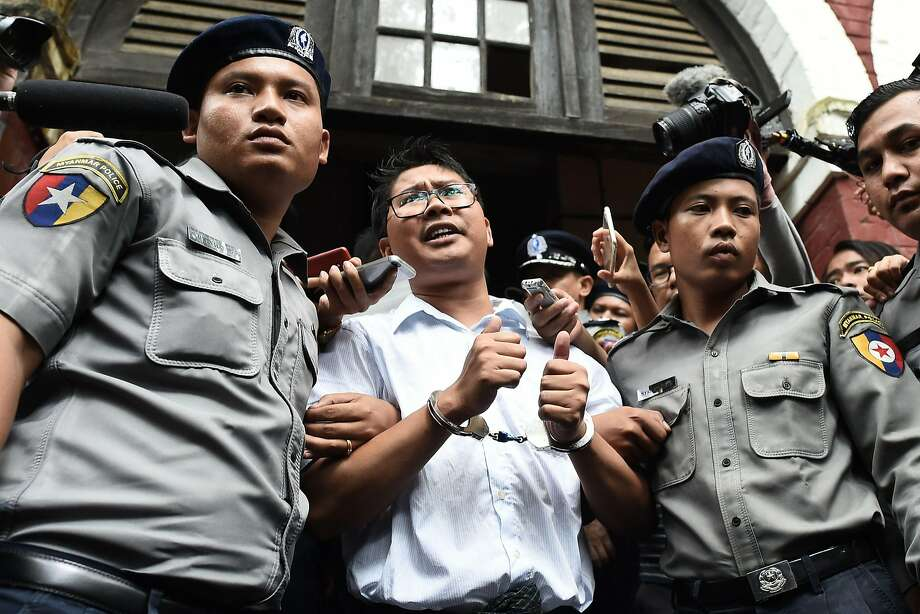 Police officers in Yangon escort journalist Wa Lone after he was sentenced to seven years in prison. Photo: Ye Aung Thu / AFP / Getty Images
