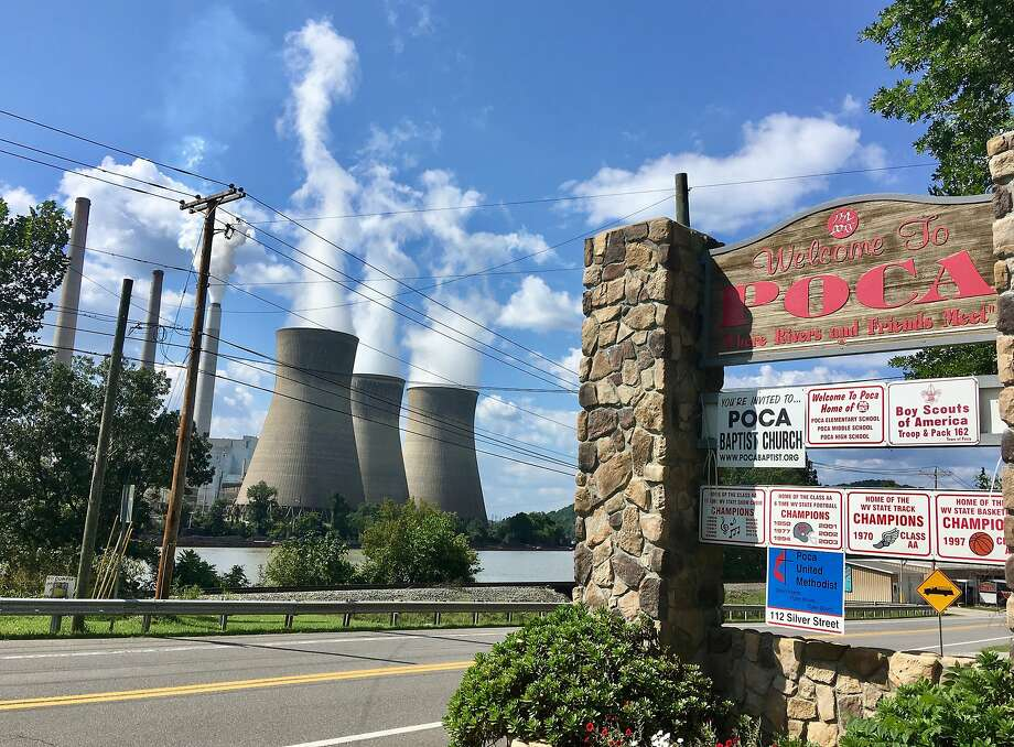 In this Aug. 23, 2018 photo, American Electric Power's John Amos coal-fired plant in Winfield, W.Va., is seen from the town of Poca across the Kanawha River. President Donald Trump picked West Virginia where he announced rolling back pollution rules for coal-fired power plants. But he didn't mention that the northern two-thirds of West Virginia, with the neighboring part of Pennsylvania, would be hit hardest.  (AP Photo/John Raby) Photo: John Raby, Associated Press