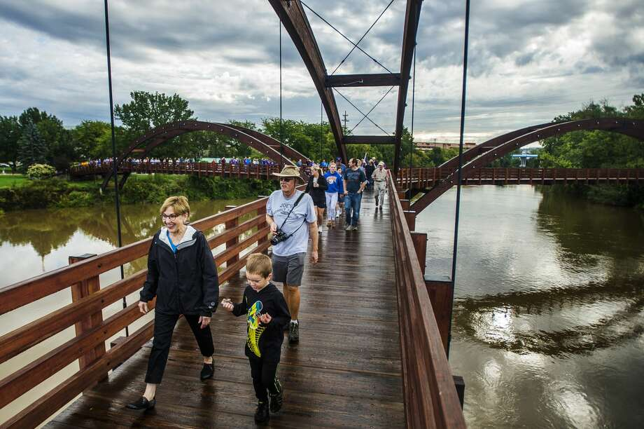 Mayor Maureen Donker, left, and Jack Brigham, 5, right, walk across the Tridge during the 27th annual Tridge Walk on Monday, Sept. 3, 2018 in Chippewassee Park. (Katy Kildee/kkildee@mdn.net) Photo: (Katy Kildee/kkildee@mdn.net)