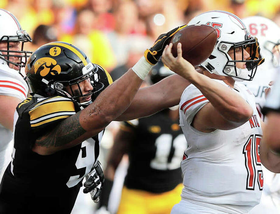 Iowa defensive end A.J. Epenesa (left) gets to Northern Illinois quarterback Marcus Childers during the second half of a college football game Saturday in Iowa City, Iowa. The 19-year-old Epenesa, a 6-foot-5, 277-pound sophomore from Edwardsville, had a sack and forced fumble the Hawkeyes recovered. He finished with four tackles and a team-leading two QB hits in Iowa's 33-7 victory. Epenesa was the Telegraph Player of the Year as a senior with the Edwardsville Tigers. Photo: Associated Press