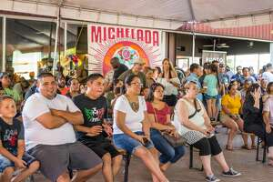 People gathered at the Alamo Beer Company to find the best michelada at Michelada Madness.