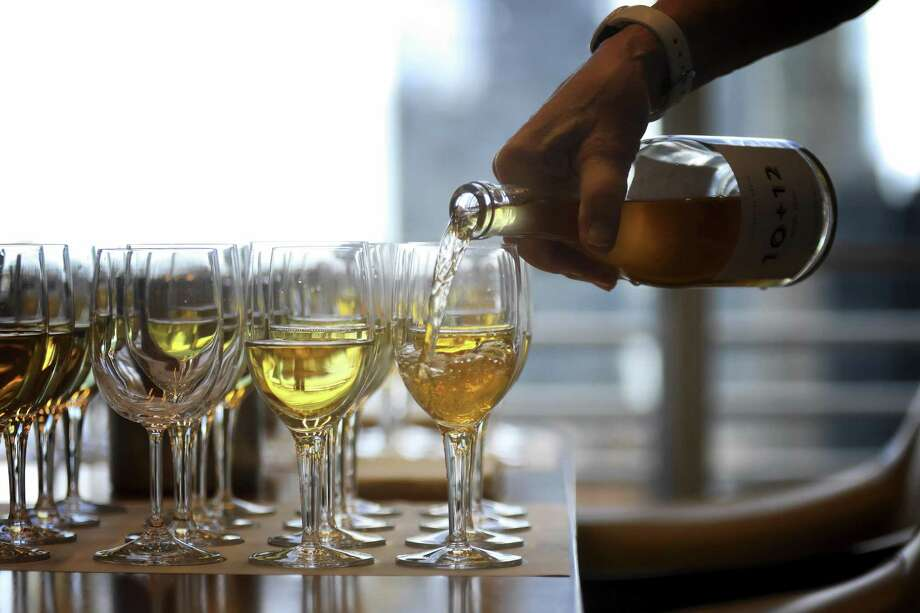 A tasting of Greek white wines at The New York Times offices in Manhattan, June 25, 2018. Though assyrtiko, from the island of Santorini, is becoming better recognized, even most wine lovers would consider it exotic. And fewer still have tasted Greece's other white varietals, like moschofilero, roditis and savatiano, athiri, robola and malagousia.  (Rick Loomis/The New York Times) Photo: RICK LOOMIS, STR / NYT / NYTNS