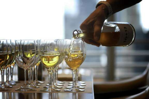 A tasting of Greek white wines at The New York Times offices in Manhattan, June 25, 2018. Though assyrtiko, from the island of Santorini, is becoming better recognized, even most wine lovers would consider it exotic. And fewer still have tasted Greece's other white varietals, like moschofilero, roditis and savatiano, athiri, robola and malagousia.  (Rick Loomis/The New York Times)