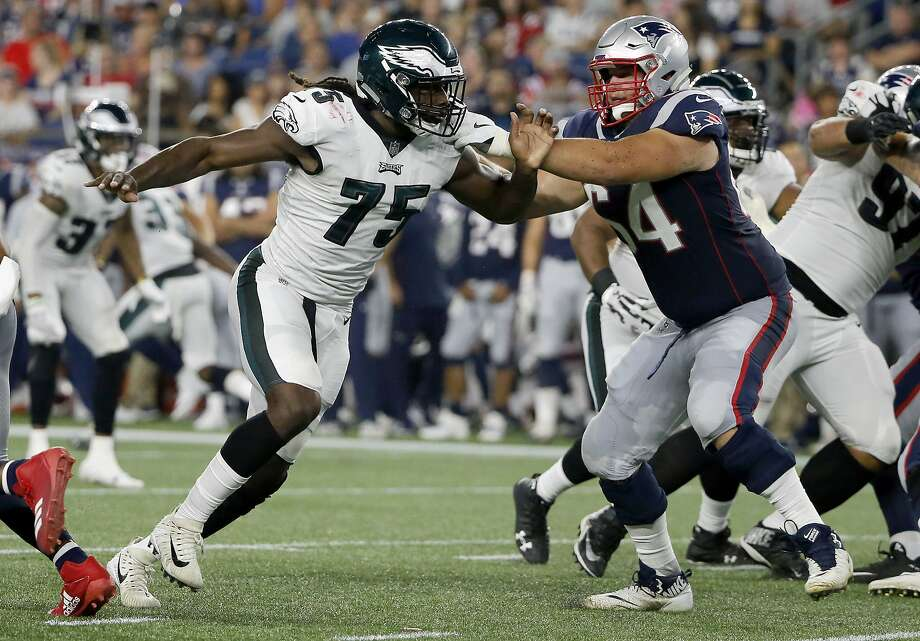 Philadelphia Eagles defensive end Josh Sweat (75) tries to get past the blocking of New England Patriots tackle Matt Tobin (64) during the second half of a preseason NFL football game, Thursday, Aug. 16, 2018, in Foxborough, Mass. Photo: Mary Schwalm / Associated Press