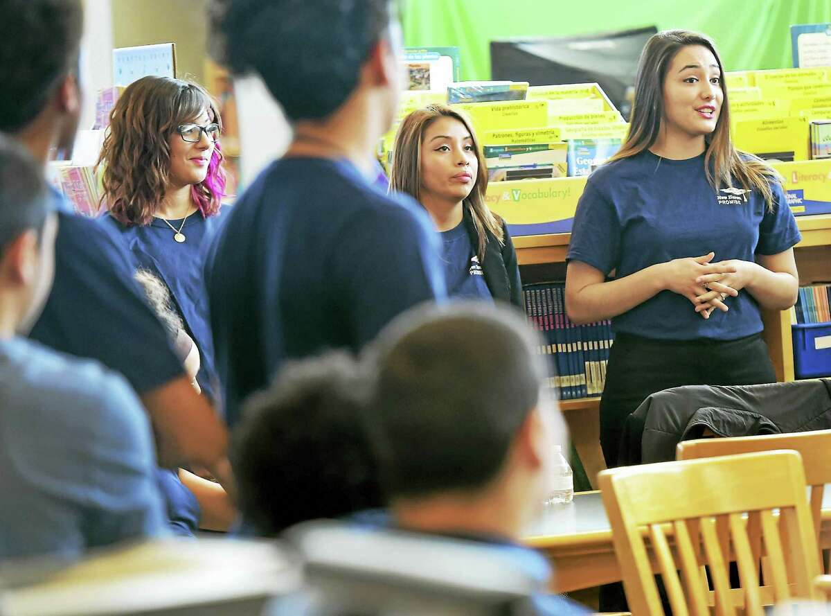 (Peter Hvizdak - New Haven Register) ¬ New Haven Promise college scholars Cristal Guevara of Southern Connecticut State University, Dulcemaria Cortes of Central Connecticut State University andLeijem Chang of the University of Bridgeport all graduates of New Haven Co-op High School, left to right, speak to John Daniels School 8th-graders about their New Haven Promise tuition-freescholarship and encouraging them to stay on the path for college readiness and getting their own New Haven College Scholarships Friday, March 18, 2016. ¬