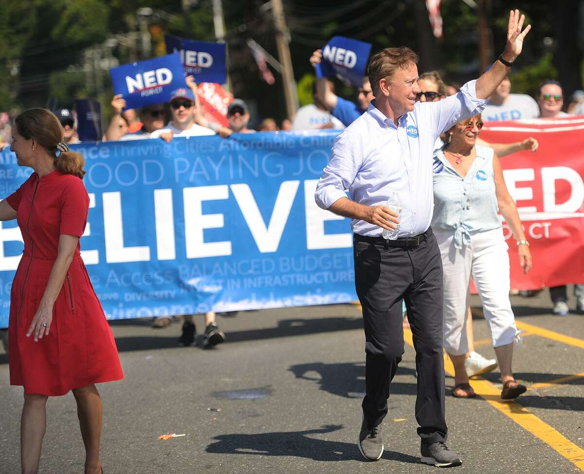 Democratic candidates for governor Ned Lamont and lieutenant governor Susan Bysiewicz march in the annual Newtown Labor Day Parade on Main Street in Newtown, Conn. on Monday, September 3, 2018.