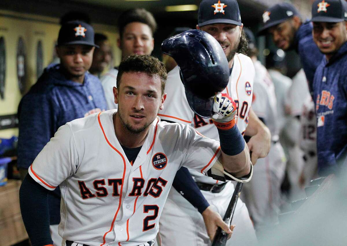 Houston Astros third baseman Alex Bregman (2) makes eye contact with the cameras in the dugout after hitting a solo home run in the first inning against the Minnesota Twins at Minute Maid Park on Monday, Sept. 3, 2018 in Houston.