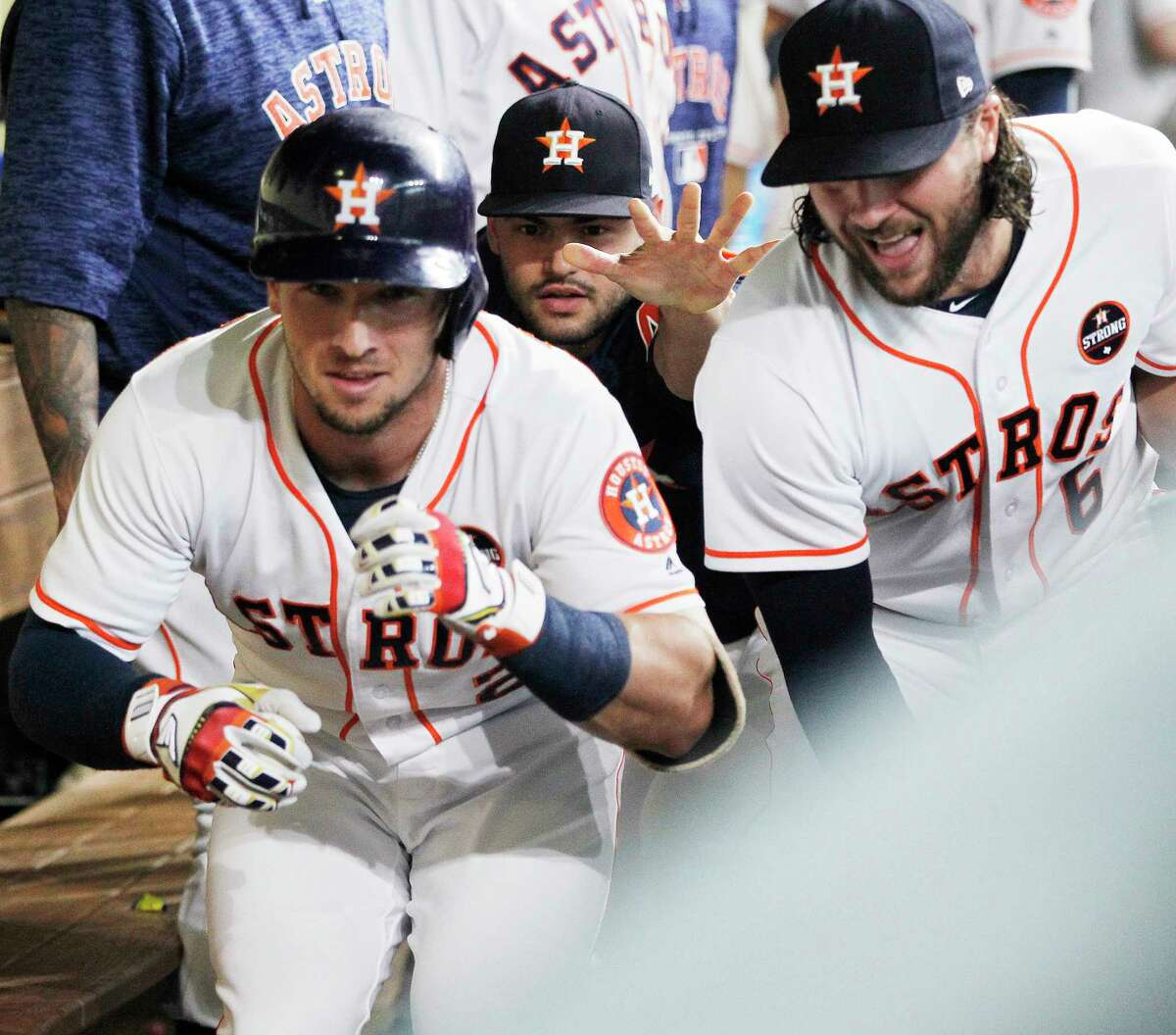 Houston Astros third baseman Alex Bregman (2) along with Houston Astros center fielder Jake Marisnick (6) and Houston Astros starting pitcher Lance McCullers Jr. (43) celebrate his solo home run in the dugout against the Minnesota Twins at Minute Maid Park on Monday, Sept. 3, 2018 in Houston.