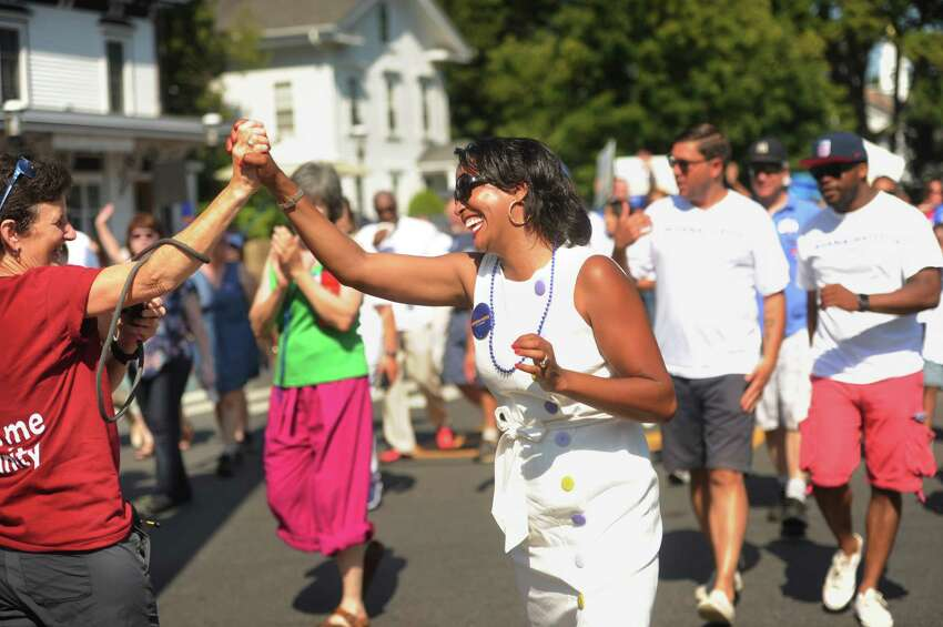 Democratic candidate for state representative Jahana Hayes marches in the annual Newtown Labor Day Parade on Main Street in Newtown, Conn. on Monday, September 3, 2018.