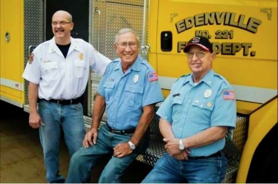 From left, Edenville Township Fire Chief Roger Dufresne, and volunteer firefighters Jim Vanderbush and Dick Bacon pose for a portrait at the Edenville Township Fire Station last fall. Between the three of them, they have more than 135 years of service to the department. (Katy Kildee/kkildee@mdn.net)