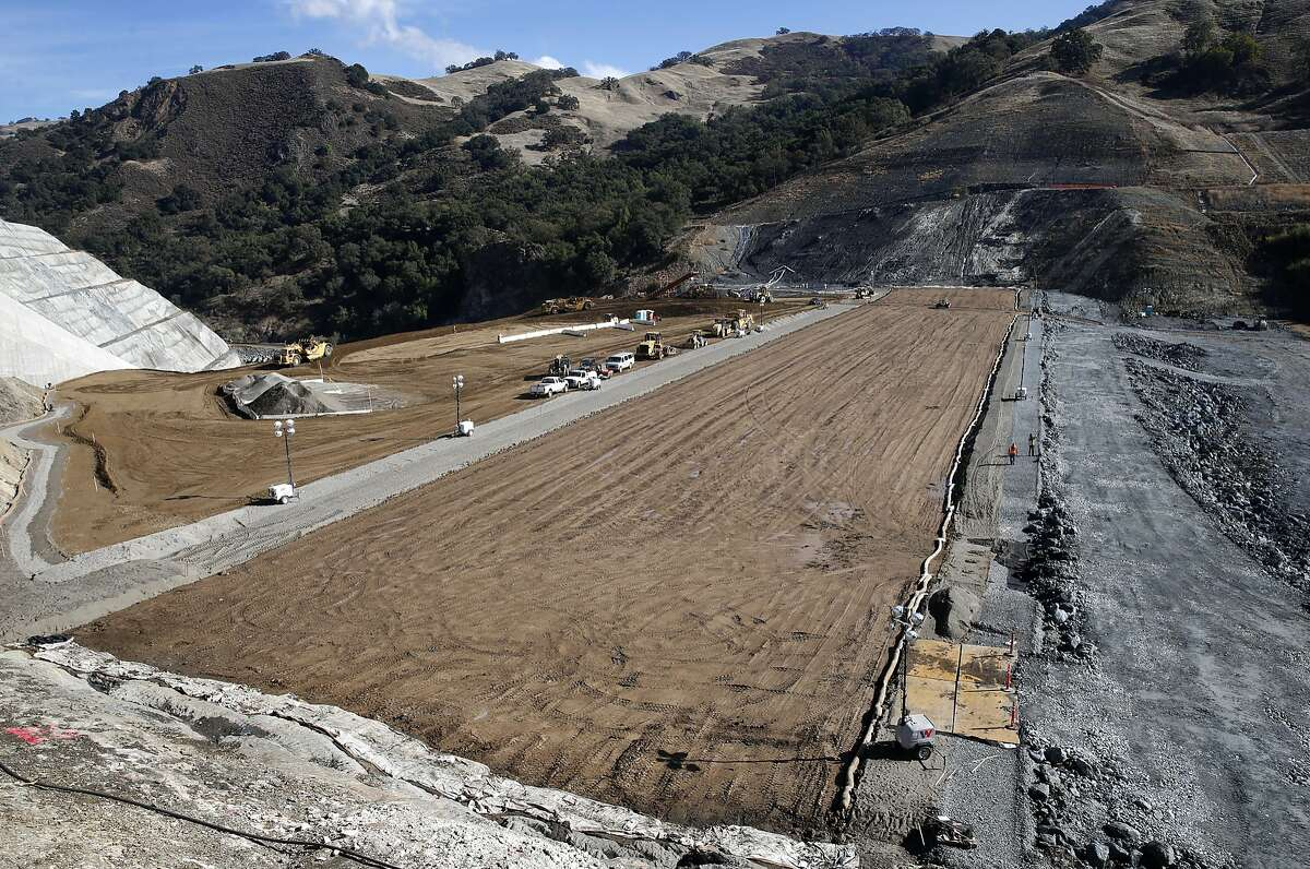 The core of the Calaveras Dam replacement project takes shape (center) with the rock-based reservoir side of the new dam seen (right) near Sunol, Calif. on Tuesday, Nov. 14, 2017. Construction crews have raised about half of the height of the new dam. The SFPUC is replacing the original seismically unreliable dam, which was completed in 1925, with a 220-foot high rock and earthen dam.