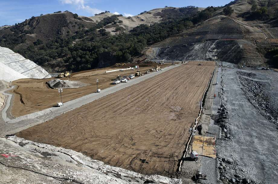 The Calaveras Dam replacement project takes shape (center) with the rock-based reservoir side of the new dam seen (right) near Sunol. The new structure will replace the original seismically unreliable dam, which was completed in 1925. Photo: Paul Chinn / The Chronicle 2017