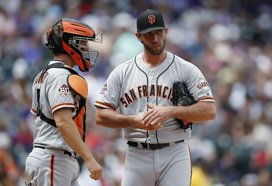 Nick Hundley confers with Madison Bumgarner during a four-run Rockies first inning.A Giants offense that totaled five hits over its two prior games showed a lot of life after Madison Bumgarner put the team in holes of 4-0 and 7-2 in the second-worst of his 15 starts here. Photo: David Zalubowski, Associated Press