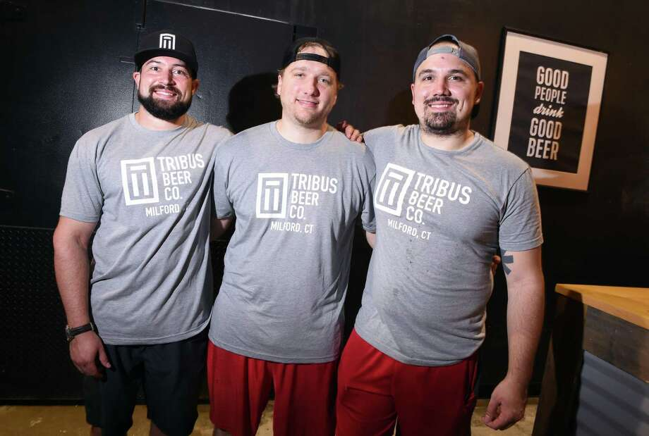 From left, Tribus Beer Company owners Sean O'Neill, Matt Weichner and Sebastian D'Agostino are photographed at their beer brewery and tap room in Milford on August 29, 2018. Photo: Arnold Gold / Hearst Connecticut Media / New Haven Register