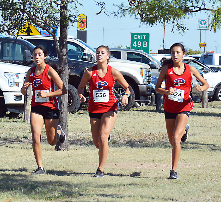TAKING IN STRIDE Plainview runners (l-r) Kelsie Valdez, Aspin Miller and Mikayla Carillo almost match stride for stride out of the starting gate during the Plainview Invite on Saturday at Kidsville Regional Park. Photo: Alexis Cubit/Plainview Herald