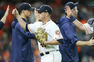 Houston Astros relief pitcher Brad Peacock (41) is congratulated as he leaves the field after the team's 4-1 win against the Minnesota Twins at Minute Maid Park on Monday, Sept. 3, 2018 in Houston.
