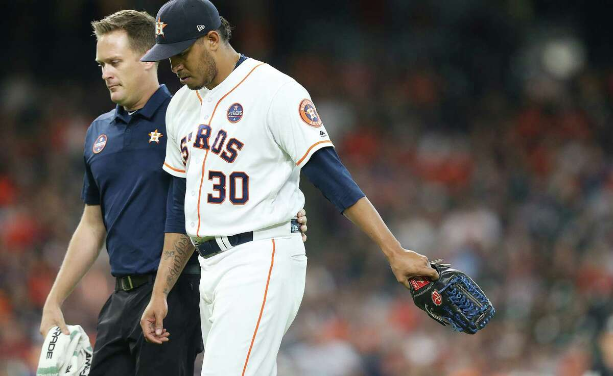 Houston Astros relief pitcher Hector Rondon (30) leaves the game after being hit by a ball hit by Minnesota Twins center fielder Jake Cave (60) in the ninth inning at Minute Maid Park on Monday, Sept. 3, 2018 in Houston. Houston Astros won the game 4-1.