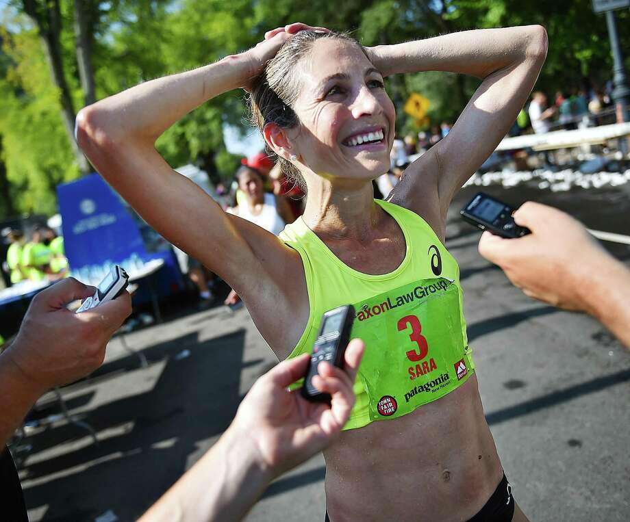 Sara Hall, 35, of Flagstaff Arizona talks to the media at the finish line following her USATF 20 km Championships win in 1:09:04 at the Faxon Law New Haven Road Race  Monday, September 1, 2018 in downtown New Haven. Photo: Catherine Avalone / Hearst Connecticut Media / New Haven Register