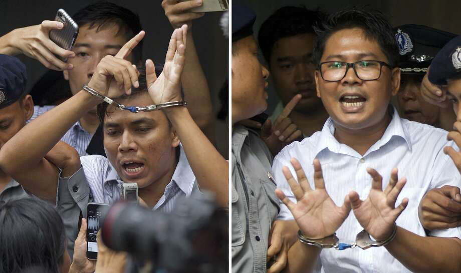Journalists Kyaw Soe Oo (left) and Wa Lone were escorted by police out of a Yangon courtroom. Photo: Thein Zaw / Associated Press