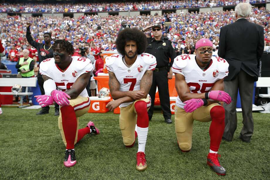 ORCHARD PARK, NY - OCTOBER 15: Eli Harold #58, Colin Kaepernick #7 and Eric Reid #35 of the San Francisco 49ers kneel in protest on the sideline, during the anthem,  prior to the game against the Buffalo Bills at New Era Field on October 16, 2016 in Orchard Park, New York. The Bills defeated the 49ers 45-16. (Photo by Michael Zagaris/San Francisco 49ers/Getty Images) Photo: Michael Zagaris/Getty Images