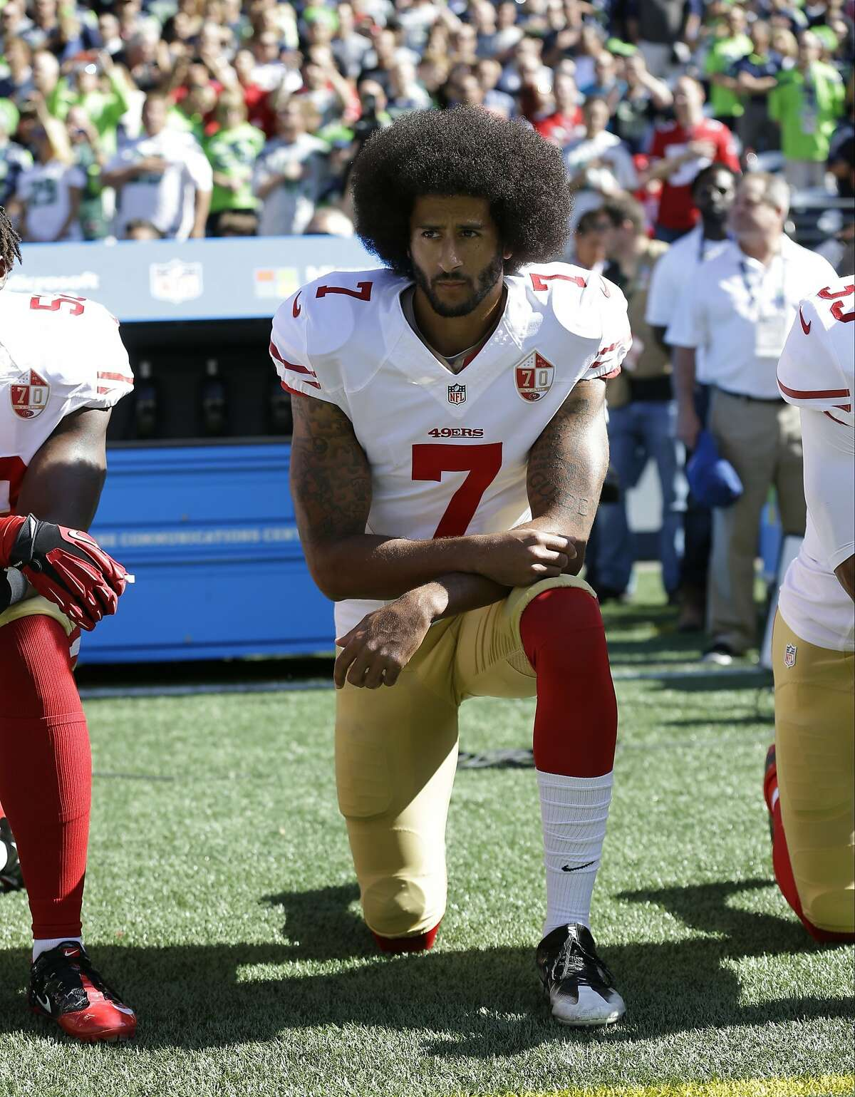 """FILE - In this Sept. 25, 2016, file photo, San Francisco 49ers' Colin Kaepernick kneels during the national anthem before an NFL football game against the Seattle Seahawks, in Seattle. Kaepernick has a new deal with Nike, even though the NFL does not want him. Kaepernick's attorney, Mark Geragos, made the announcement on Twitter, calling the former 49ers quarterback an """"All American Icon"""" and crediting attorney Ben Meiselas for getting the deal done. (AP Photo/Ted S. Warren, File)"""