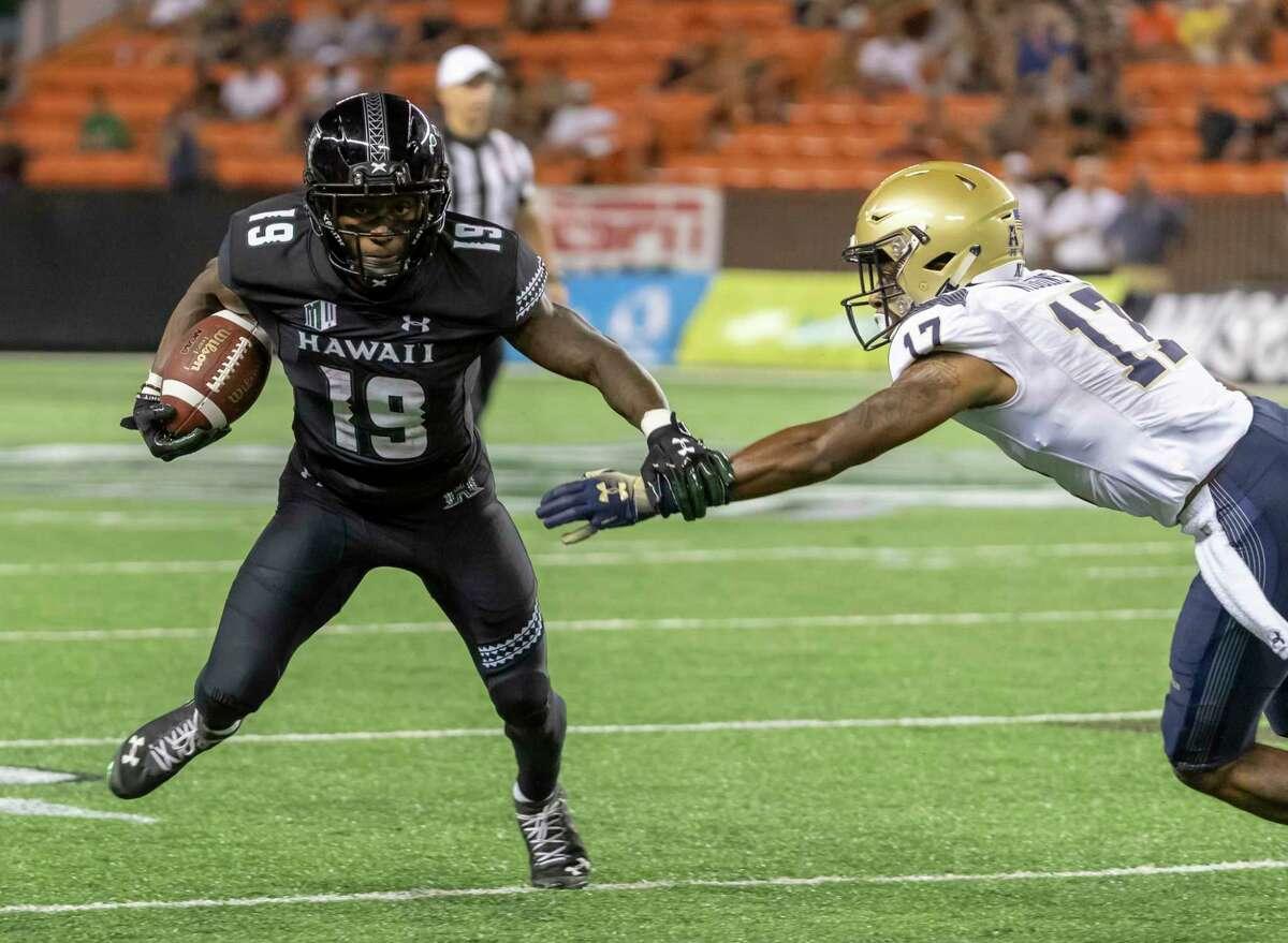 Hawaii wide receiver JoJo Ward (19) slaps away Navy cornerback Marcus Wiggins (17) hand in the second half of an NCAA college football game, Saturday, Sept. 1, 2018, in Honolulu. (AP Photo/Eugene Tanner)