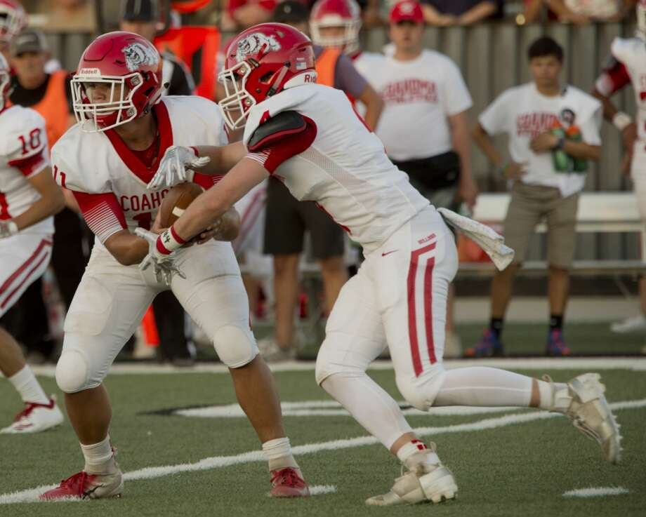 Coahoma's Zack Schneider looks to handoff to Gaige Hill 08/30/18 in a game against Forsan in Big Spring. Tim Fischer/Reporter-Telegram Photo: Tim Fischer/Midland Reporter-Telegram