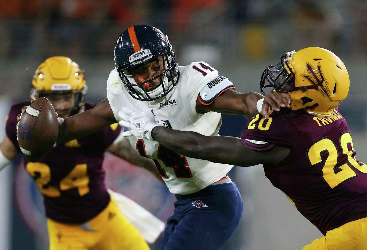 UTSA quarterback Cordale Grundy (14) stiff arms Arizona State linebacker Khaylan Thomas (20) during the second half of an NCAA college football game, Saturday, Sept. 1, 2018, in Tempe, Ariz. (AP Photo/Ralph Freso)